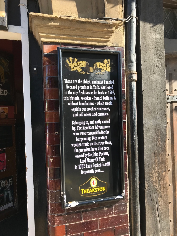 A photo of the board outside the Golden Fleece pub about hauntings.