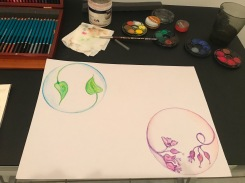 Two circles, watercolour pencils, green leaves and pink flowers